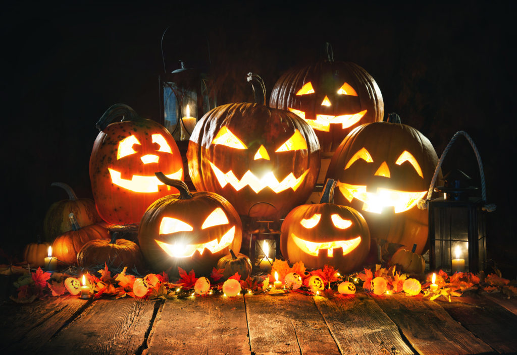 Spooky carved pumpkins used as an outdoor decoration