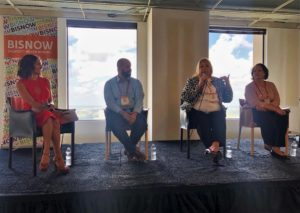 Allie Danziger moderates a Bisnow panel on the future of downtown Houston